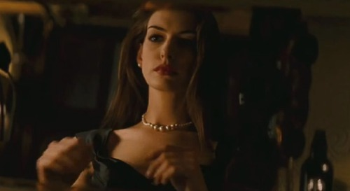So as every Batfan knows, pearls are the symbol of the murder of Bruce Wayne's parents. They're a repeated image in two Batman classics, The Dark Knight Returns and Batman: Year One, where Martha Wayne's shooting results in her pearl necklace breaking and scattering across the ground. They show up in Batman Begins, given an especial emphasis by having Bruce remembering his father actually giving them to Martha. So far, so good, right? Then we come to The Dark Knight Rises and Nolan actually does something new with the most famous iconography in comics. Selina Kyle, breaking into Wayne Manor and incidentally kickstarting Bruce Wayne back towards the suit, swipes the pearls while she's getting his fingerprints. Bruce confronts her about it and says he can't let her take them. As you might expect, he doesn't really mind that someone's stealing from him—it's more that they're his mothers' pearls. But still, he's not outraged either. He's frosty. Cordial. The pearls don't mean anything to him, not anymore, they're something he's irrationally holding onto. Deadweight. The rest of the movie, we have characters telling Bruce about his deathwish, how he doesn't have to keep being Batman, how he can have a happy life, but it isn't until the finale that he truly accepts this. And the pearls are a perfect visual metaphor of that. While faking his death, Bruce takes the time to grab them—not for himself, but as a gift for Selina.  I've noticed some people asking what the point was of Catwoman in TDKR, since most of what her character did could've been accomplished by other characters in an admittedly overfull movie. But even though she was an engaging, entertaining character in her own right, her real importance to the story is in symbolism. If Bruce just faked his death and ran off to Italy, we'd have no way of knowing he wouldn't become a hermit again or even be drawn into becoming Batman once more. By showing him with Selina, we can see he's taken the film's lesson to heart. It's not just that he lets go of the pearls, it's that he gives them to Selina. He's moving on. He's releasing both the stigma of his parents' murder and the fantasy of a romance with Rachel, something that never would've worked, something that was proven to be impossible; and proven again with Miranda Tate, a seemingly-similar character to Rachel, idealistic and comforting, but now twisted into a deathly apparition. Selina is someone who can understand what he's been through, because she's been there herself. The idea of a lover as saintly redeemer is gone. Selina is Bruce's partner and equal, as reiterated throughout the movie in both action and dialogue. And in the end, the pearls that were originally intended by Thomas Wayne as a gift for his wife come full circle. They're not a symbol of death anymore. They're not deadweight anymore. In giving them to Selina, Bruce once more gives them meaning. They are, again, a token of affection.