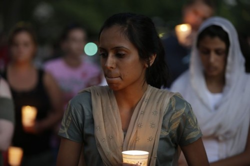 thebengalcat:  Mourners take part in a candlelight vigil for the victims of the Sikh Temple of Wisconsin shooting, in Milwaukee, on Sunday August 5, 2012. A white gunman killed six people at a Sikh temple in suburban Milwaukee in a rampage that left terrified congregants hiding in closets and others texting friends outside for help. The suspect was killed outside the temple in a shootout with police officers. AP