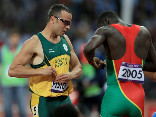 onmy88:  Kirani James (Grenada) and Oscar Pistorius (South Africa) exchange name tags after one of the semifinals of the Men's 400m race. Kirani finished first, and Oscar, who has 2 prosthetic legs finished last. One of the best moments of the 2012 Olympics thus far.