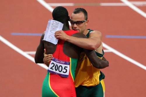 After coming in last place in the 400m semifinals, Oscar Pistorius and 1st place runner Kirani James hug and trade bibs. :3 Global sportsmanship.
