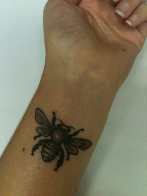 my new bee tattoo :) done by greg at inflictions in covina, ca. love, love, love it.