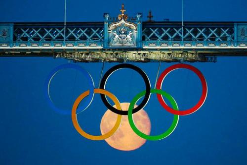 Full moon appears to form sixth Olympic ring under Tower Bridge in London