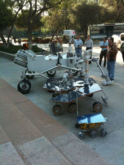 "discoverynews:  This is a great photo. The newest Mars rover is nearly the size of a Mini Cooper! wordbk:  spytap:  In honor of Curiosity's successful landing, I present ""Three Generations,"" courtesy of John Klose , JPL employee since 2002. It shows the Mars landers Spirit (foreground), Opportunity (middle), and Curiosity (background) taken in front of JPL building 180, aka the Directors building.    HAVE TO REBLOG."