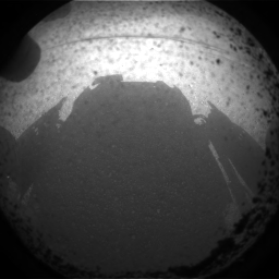 Curiosity looks at its shadow on the Martian surface. Beautiful. Also: The first image sent from Curiosity!