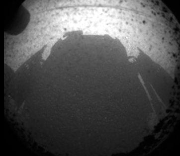 iheartchaos:  Here it is, the first image sent from the surface of Mars from the Curiosity rover It's the shadow of the rover across the surface of the red planet. The original image size first came in at just 64x64.