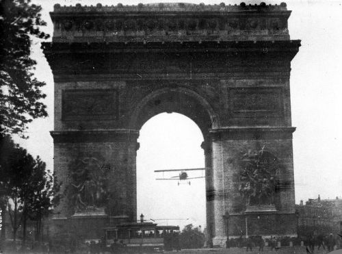 "Charles Godefroy flies through Arc de Triomphe, 7th of August 1919, Jacques Mortane @credits  Charles Godefroy (29 December 1888 at La Flèche (Sarthe) – 11 December 1958 at Soisy-sous-Montmorency, (Val d'Oise), north of Paris) was a French aviator who became famous by his spectacular flight passing through the Arc de Triomphe in Paris in 1919. On 7 August 1919, three weeks after the victory parade, under cover of secrecy and dressed in his warrant officer uniform, Charles Godefroy took off at 7.20 a.m. from the airfield of Villacoublay in a biplane ""Nieuport 11 Bébé"" (Bébé = baby - because of its low wing span of 24.67 ft / 24'8'' or 7.52 m). He reached the Porte Maillot shortly thereafter. Coming from the west, he circled the Arc de Triomphe twice and began the approach along the Avenue de la Grande-Armée. He gathered speed and forced the plane down and through the Arc. He did not have much clearance – the width of the Arc is 47.57 ft / 47'6'' (14.50 m). He passed at a low level over a tram in which passengers threw themselves to the ground, and many passers-by ran away frightened. Godefroy flew over the Place de la Concorde before returning to the airfield, where his mechanic checked over the engine. No one at the airfield had taken any notice of the flight, which had lasted half an hour.  The journalist Jacques Mortane had the whole event filmed and photographed. Articles have been published in many newspapers.The film screening was banned by the Commissioner of Police.Godefroy stayed officially in the background, but his name could not be kept secret for long. The authorities disapproved of the event and were afraid of it being imitated, but Godefroy escaped with only a warning."
