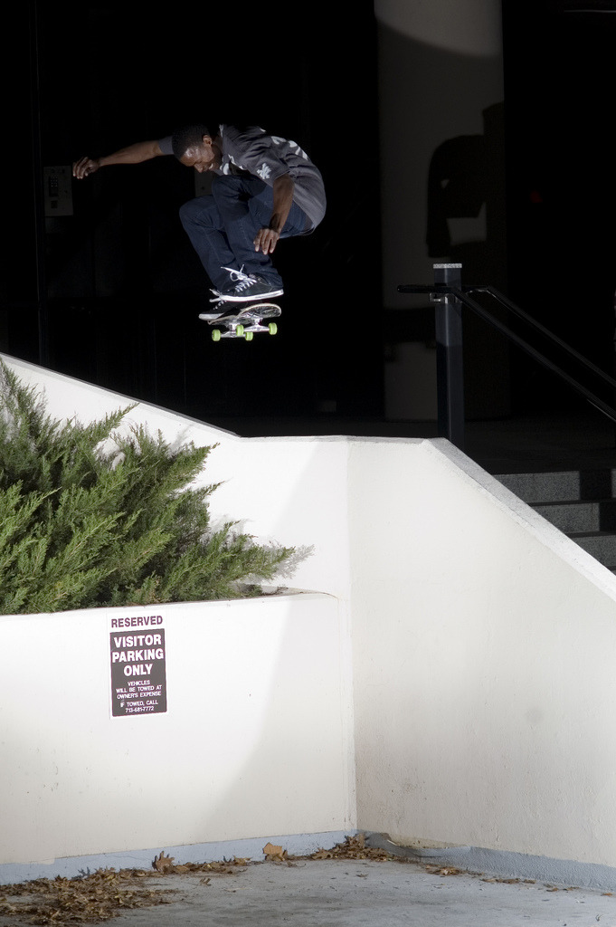 Dallis kick flipping over Voss Wall-Houston-2009