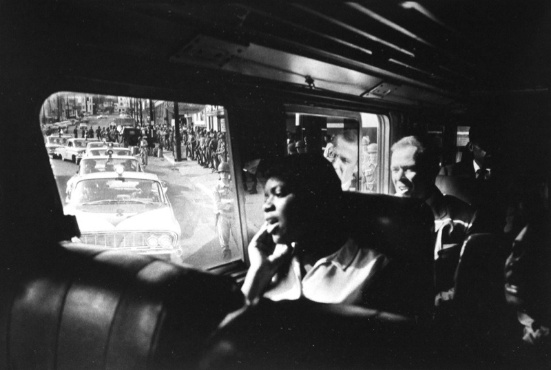 National Guard soldiers escort Freedom Riders along their ride, 1961. By Bruce Davidson