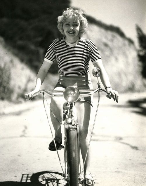 Alice White rides a bike.