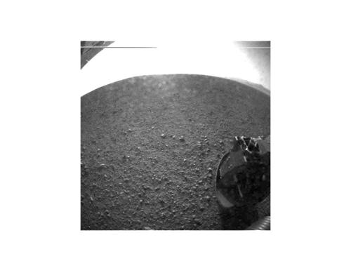 "inothernews:  WELCOME TO MARS   This is one of the first images taken by NASA's Curiosity rover, which landed on Mars the evening of Aug. 5 PDT (morning of Aug. 6 EDT). It was taken through a wide-angle lens on the left ""eye"" of a stereo pair of Hazard-Avoidance cameras on the left-rear side of the rover. The image is one-half of full resolution. On the top left, part of the rover's power supply is visible.  (Photo via NASA)"