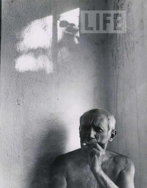 Picasso smoking a cigarette in Vallaruis, France, 1949
