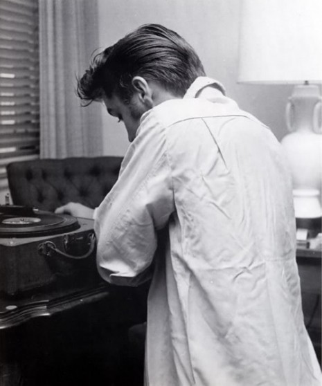 More Elvis listening to records.  theniftyfifties:  Elvis puts a record on.