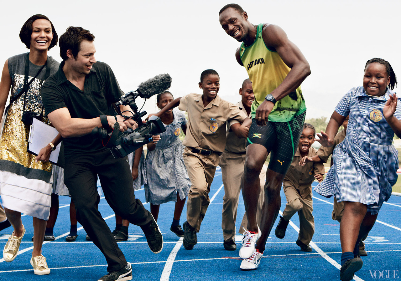 Gold medalist Usain Bolt with Joan Smalls.Photographed by Patrick Demarchelier, Vogue, June 2012See the slideshow