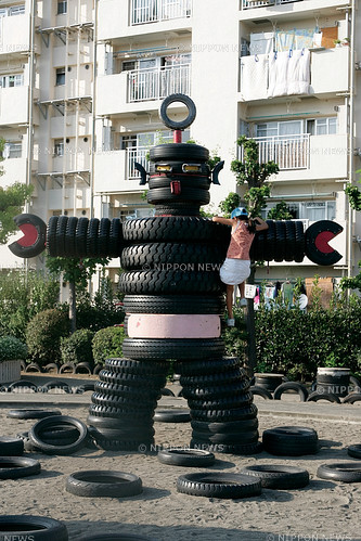 I love the pink belt this Tire Robot is wearing. Very fashion forward and from the looks of it green design too! Another great robot from our friends in Japan. This is in a Tire Park in Tokyo! Anyone seen / played at this park? playgroundparents:  Tokyo Tire Park has been discovered! The Nishi Rokugo Koen in Tokyo, Japan is made of tires, tires, and more tires (over 3000 tires to be exact). There is a tire swing, a tire robot and a tire gorilla looking things. By the looks of it, I think there might also be a tire SLIDE! Wow, we need more pictures and experience from people there in Tokyo! photo by Laurent Benchana/Nippon News