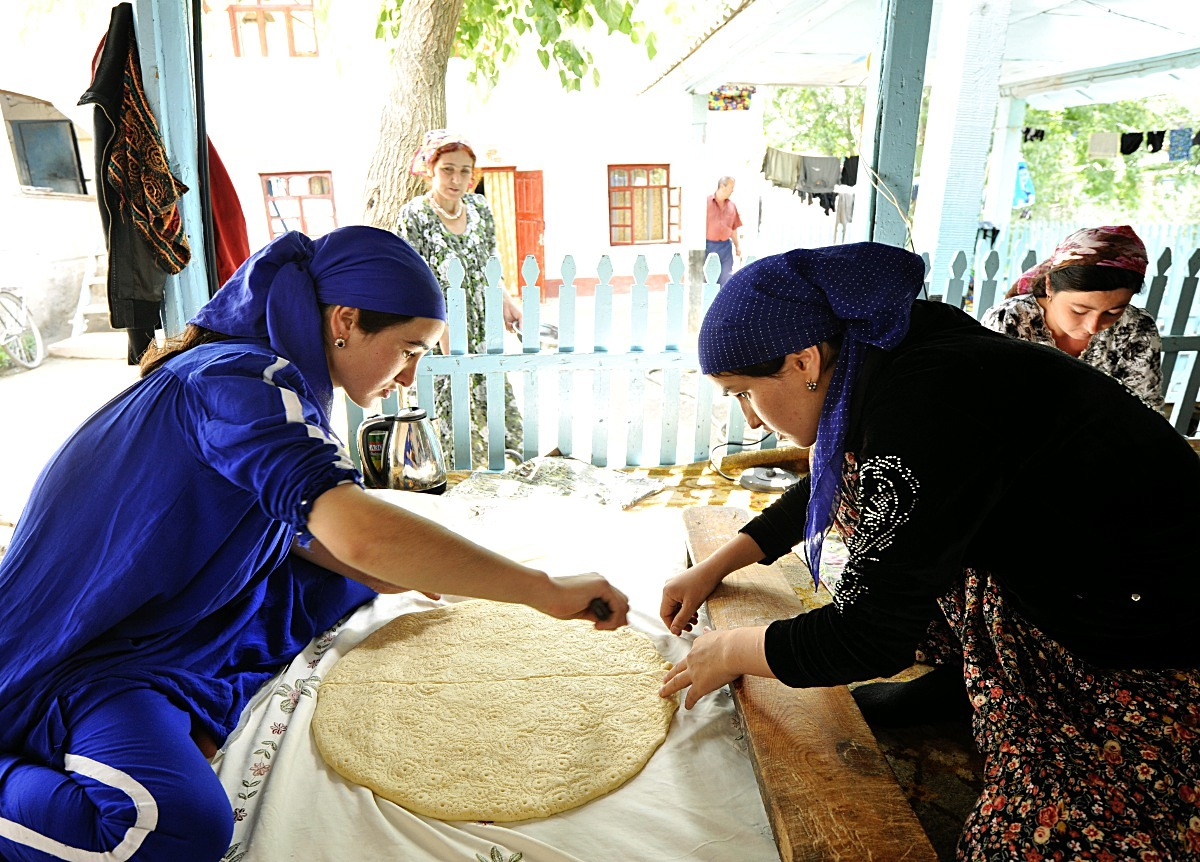 Tajik women making bread to deep fry for a Ramadan feast. Taking during the fighting in Khorog…life continues as usual just 200km away. Tajikistan, 2012