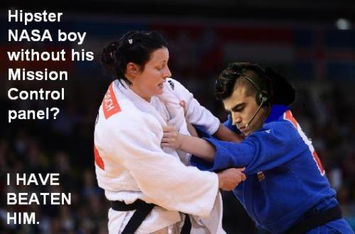 We think Olympic judo champ Edith Bosch — who punched a drunk spectator after he threw a bottle at the 100m sprinters — deserves to be as much of a meme as NASA mohawk guy. (And, yes, we made this photo collage using Microsoft Paint.)