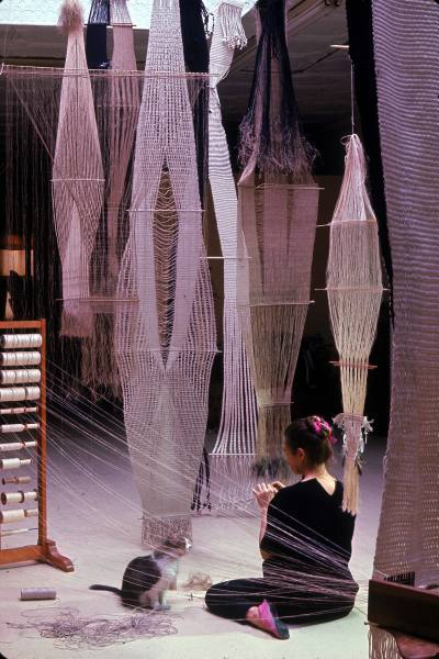Artist and weaver Lenore Tawney at work on a tapestry, circa 1966.