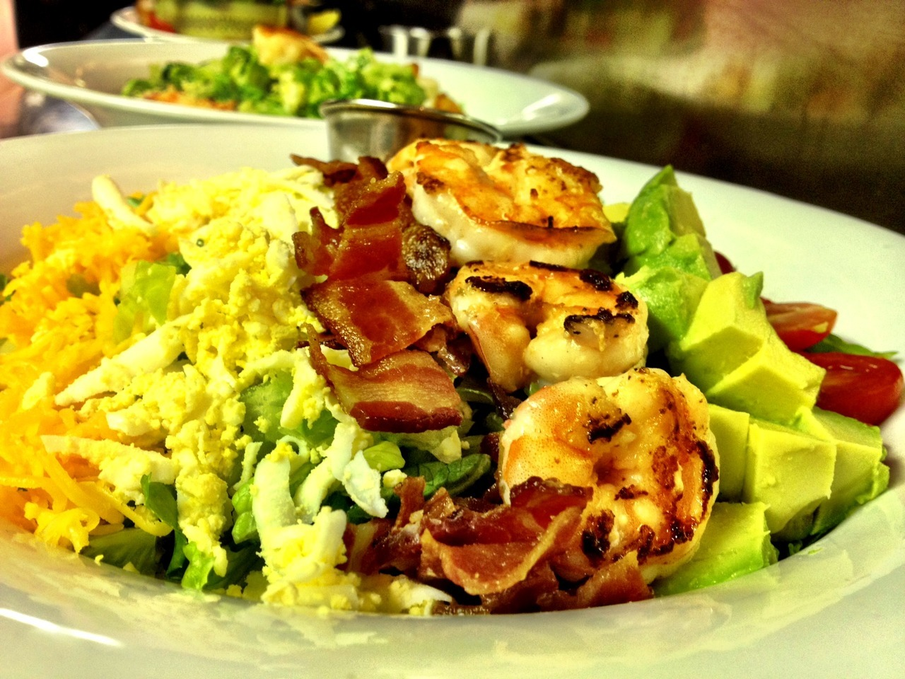 Monday Dish: our classic Cobb Salad with grilled shrimp. $18.50. Optional grilled chicken or try combo.