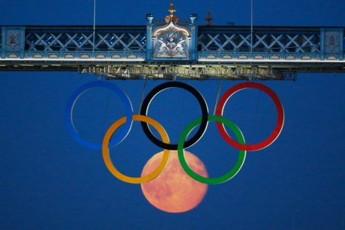 theblueangelstar:  Perfect Timing! Full moon compliments the Olympic Rings below the Tower Bridge in London Yesterday