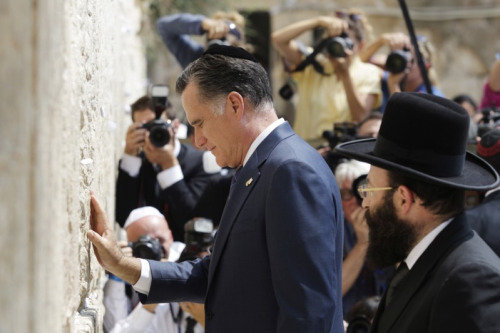 "ericmortensen:  Mitt Romney secretly baptizes the Western Wall into the Mormon faith.       At this very moment he's praying his ""magic underwear"" doesn't burst into flames."