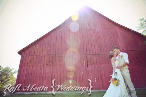 Rustic Wedding in Boise- photo in front of barn Raftmedia.com