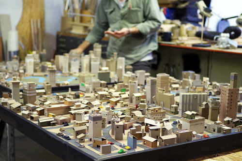 "Artist Kiel Johnson created a tiny paper city he calls ""Paper Metropolis"" from chipboards and various other paper pieces. These cities are fully realized with stadiums, power lines and real-life places like Time Square. Paper, to Kiel, is more than just something you can write on or recycle to make more paper. Paper is the building block of creativity. You can check out more photos and hear Kiel's story here."