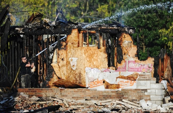 freekicks:  nbcnews:  Mosque in Missouri burns to the ground one month after arson attack (Photo: T. Rob Brown / AP) A mosque in Joplin, Mo., that was targeted by an arsonist on July 4 burned to the ground on Monday. The fire at the Islamic Society of Joplin was reported around 3:30 a.m. by a person driving past the building, said Bridget Patton, spokesperson for the FBI in Kansas City, Mo. Read the complete story.  This is the second time this mosque has been targeted by arsonists.  The first attempt was on JULY 4TH.  The FBI even has video footage of the last attack and a motherfucking camera still of the guy, but no one has identified him.  Tumblr, I give you the face of evil: