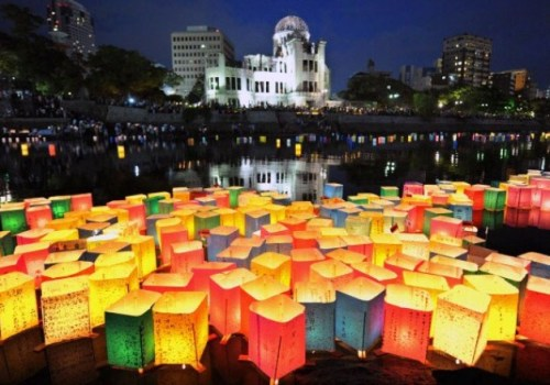Paper lanterns float in front of Hiroshima Peace Memorial during a ceremony to mark the first atomic bombing. The US dropped the bomb on Hiroshima on 6 Aug. 1945, killing an estimated 140,000 people.