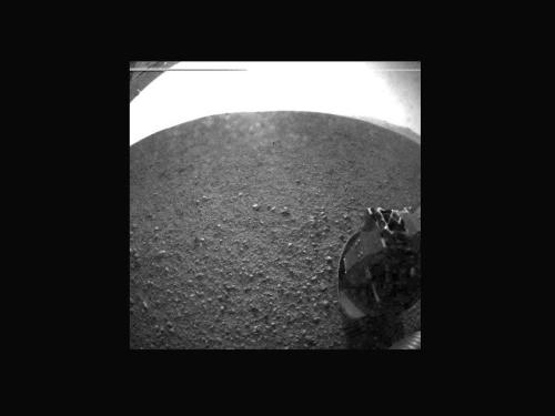 One of the first ACTUAL images from the Curiosity Rover.  Here's a link explaining when and what to expect!  http://www.nasa.gov/mission_pages/msl/news/msl20120803.html