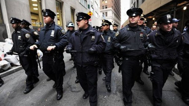 "New York Times Says NYPD Brutalized A Photographer  The New York Times has complained to the city's police department after one of its photographers said he was assaulted by officers who arrested him on Saturday.  Robert Stolarik, a freelance photographer, claimed a New York Police Department (NYPD) officer ""slammed"" his camera into his face before he was dragged to the ground, kicked and arrested.  Stolarik was on assignment with two other reporters in the Bronx when he was stopped by police on Saturday evening.  Police ordered Stolarik to stop taking pictures of a teenage girl being arrested. When he refused, an officer reputedly grabbed Stolarik's camera and dragged him to the ground.  Stolarik claimed he was then kicked in the back and received scrapes and bruises on his face, legs and arms as a result of the arrest. He was charged with obstructing government administration and of resisting arrest.  The New York Times reported that a video of the arrest taken by another journalist showed Stolarik face down on the pavement beneath a huddle of about six police officers.  The police claimed that Stolarik ""inadvertently"" struck an officer in the face with his camera when he refused to leave the scene and stop taking photographs. A spokesman for the NYPD said the force had no further comment to make on Monday.  It is the third time since December the paper has written to the force about its treatment of Stolarik, who covered the Occupy Wall Street protests for the New York Times.  Police obstructed Stolarik from taking pictures of an arrest at an Occupy Wall Street rally in December 2011, and again in January."