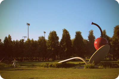 Monday, 7:00pm. Lowry Hill, Minneapolis. At the iconic Spoonbridge and Cherry sculpture in the Minneapolis Sculpture Garden. I watched the girl in the bottom left corner of the photo flappin', and jumpin' around for a good 10 minutes, trying really hard to get that perfect shot. I'm always really amused at major attractions and I always end up taking a lot of photos…of people and not of the attraction itself.