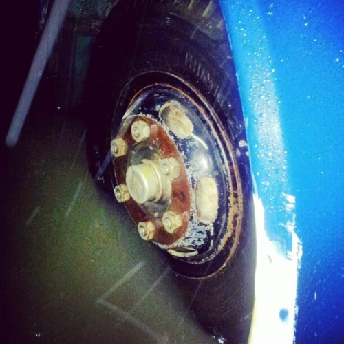 Our bus tire. #stranded #flood #Manila  (Taken with Instagram)