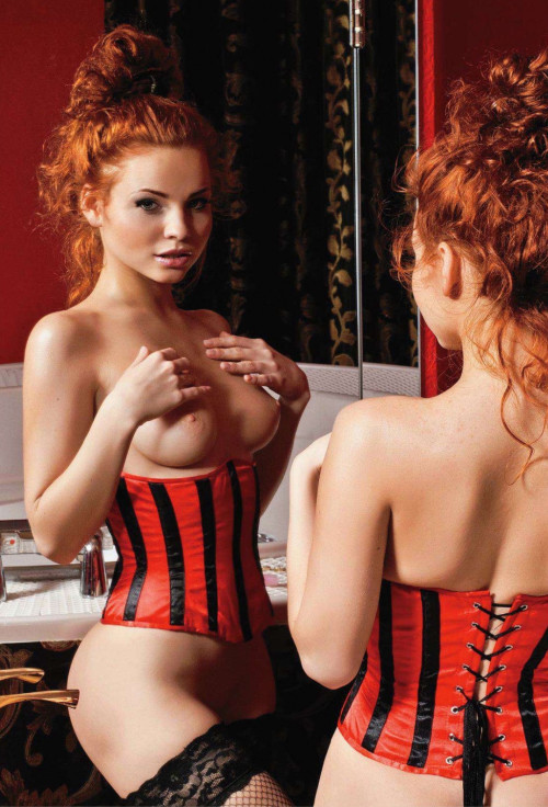 heavenlyredheads:  Sexy redhead in a red and black corset with black fishnet thigh highs.  #TittyTuesday