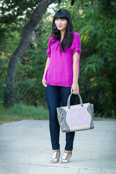"2012. lilac. joie blouse. verdugo leggings by paige. julia tote c/o danielle nicole. acrobatic wedges from anthropologie.when M saw this outfit, he said, ""ooh… purple!"" as you've noticed, the majority of my wardrobe is blue, but i've got a few tricks up my sleeve (if tricks means non-navy blouses).before we went to virginia, danielle (of danielle nicole) sent me the color-blocked bag, and i took it on our trip. the bag easily held a smaller leather clutch, my wallet, two paperbacks, our combined toiletries, and tools for crankiness prevention (sea bands, dramamine, pretzels, and gatorade). every time i carry it, i feel like mary poppins. i plan on toting it back and forth to school, but i'll leave the big umbrella at home.the look 