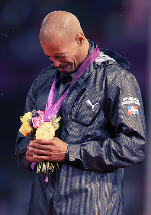 OLYMPICS DAY 10 Felix Sanchez cries on the podium as he wins the Dominican Republic their first gold medal at the 2012 games. Men's 400m Hurdles Photo by Hannah Johnston
