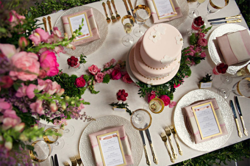 Bird's eye view of a pink & gold table setting