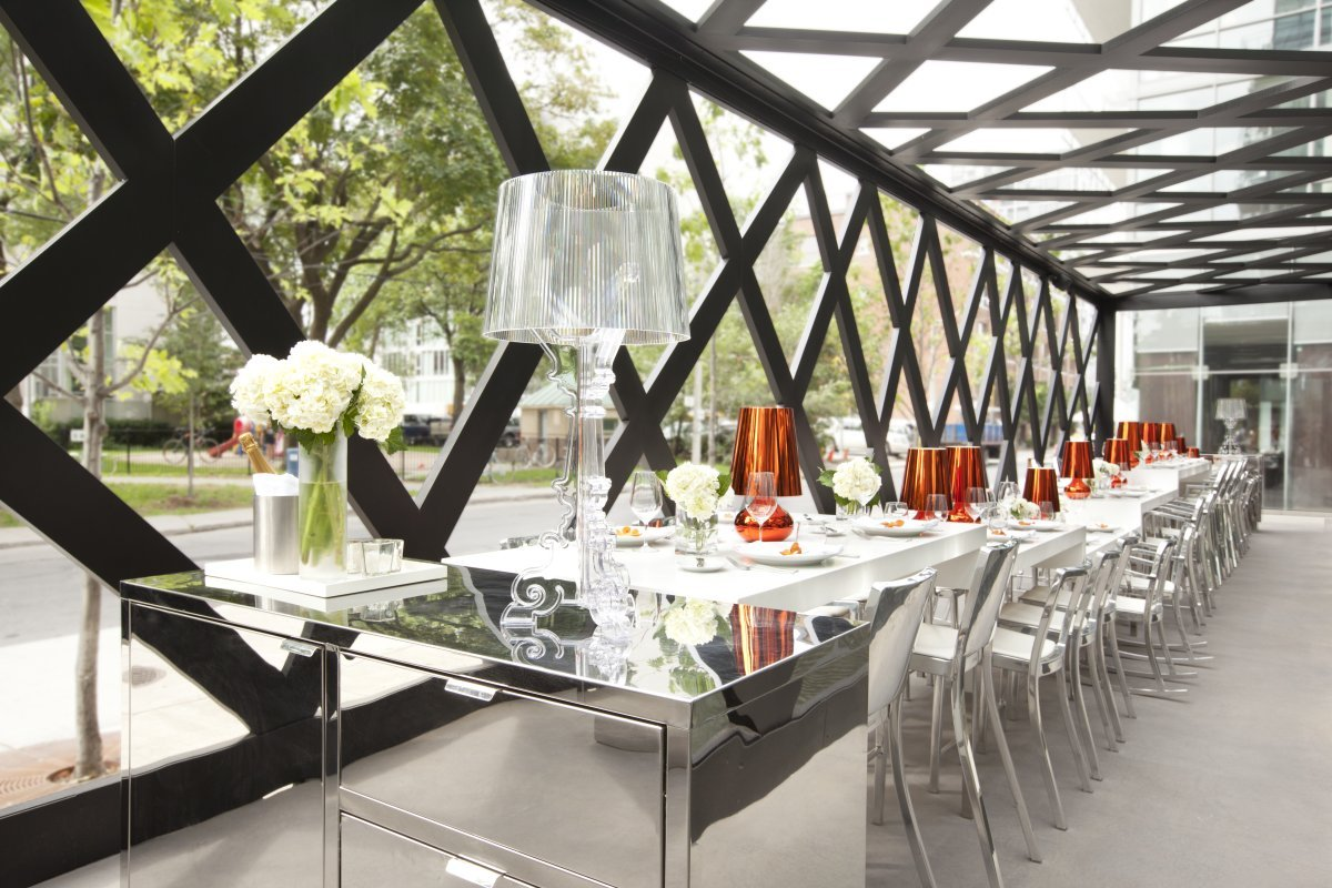 The Scarpetta Dining Pavilion in Toronto won the grand prize A.R.E Design Award. Inspired by Mad Hatters tea party, polished Icon chairs, polished Hudson stools and polished Heritage rocking chairs are mixed with different hight tables to create personal space. gh3 architectures and II BY IV Design have together created a unique outdoor dining pergola framed by the Thompson Hotel and Victoria Memorial Park. Photo by Dan Couto