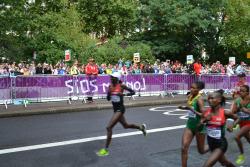 A Mad British Public: The London 2012 Olympic Marathon + the Rain It probably had something to do with a Supremely Super Saturday in which the Brits owned the athletics, but there was a feverish Olympic spirit down at the London 2012 Olympic Marathon on Sunday. A huge number of people showed up early on a weekend morning to capture some Olympic action. The size of the crowd was bizarre for two reasons: 1. There was no real British interest following Paula Radcliffe's withdrawal (a bit of shame. I wanted to hold a sweepstake on where she'd break down) 2. The weather was monumentally terrible. It bucketed it down at regular intervals from 9am till 2pm with a short interlude of thunder and lightning. The marathon did three giant loops around central London and so, with the conditions not being ideal for spectators, I expected a large majority of people to drop off as the race progressed. But the stuck with it - right up to the very end. In fact, the girl from Timor Leste trailing in last place by a good 40 minutes turned into a classic British Underdog. Even after the last significant runners had gone past, thousands of people chose to stay and cheer her on over the last lap. We are a mad bunch, but I love it!