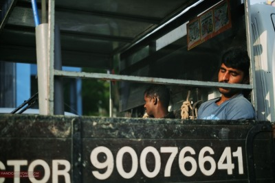 40 winks at the back of a lorry by Adrian Seah | Singapore, 2012 Fuji X-Pro1, XF 35mm f1.4