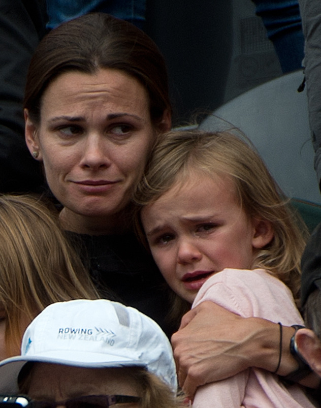 Simon Whitfield's wife Jennie and daughter Pippa cry following the news that Simon had been knocked out of the race following a crash on the bike during the men's triathlon at the London 2012 Olympic Games. The Canadian was in good position following a 1.5-kilometre swim but lost control of his bike after going over a small speed bump coming out of the transition. Whitfield veered sharply to the left and went careening off his bike into a curb and metal guard-rail. He knocked another competitor down in the process. This was expected to be his last race. (Photo: Tyler Anderson/National Post)