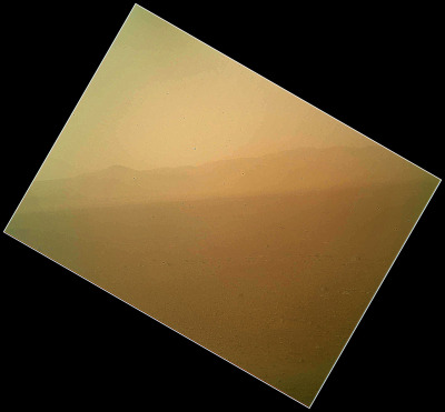 spacewatching:  This view of the landscape to the north of NASA's Mars rover Curiosity was acquired by the Mars Hand Lens Imager (MAHLI) on the afternoon of the first day after landing. (The team calls this day Sol 1, which is the first Martian day of operations; Sol 1 began on Aug. 6, 2012.)In the distance, the image shows the north wall and rim of Gale Crater. The image is murky because the MAHLI's removable dust cover is apparently coated with dust blown onto the camera during the rover's terminal descent. Images taken without the dust cover in place are expected during checkout of the robotic arm in coming weeks.