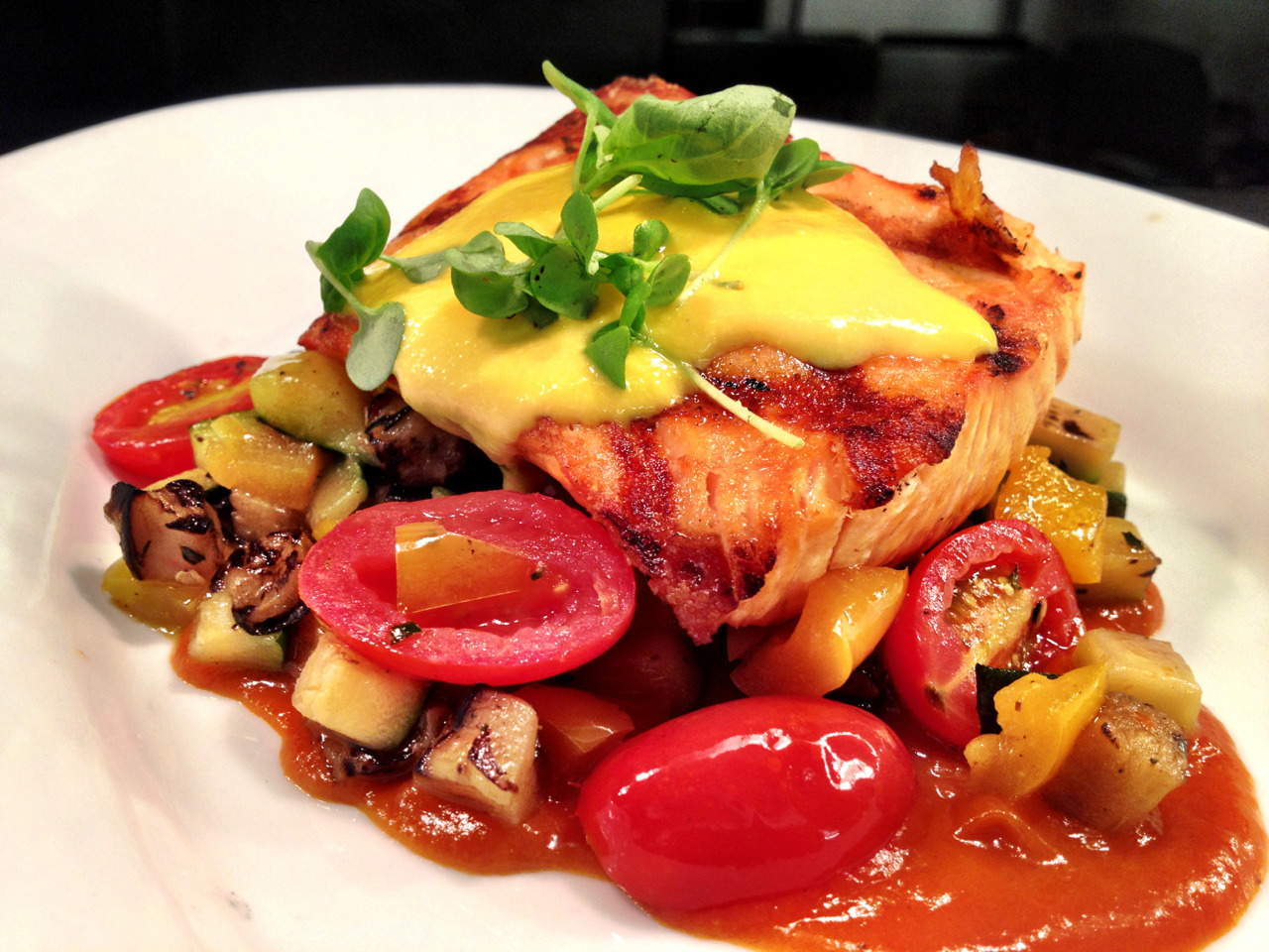 Featured dish: Grilled Atlantic Salmon, ratatouille, bell pepper coulis, corn pudding and basil. $26 lunch and dinner.