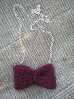 Bowties are cool, and so is this knitted necklace! Featuring a hand-knitted bow on a silver chain, this necklace was inspired by everyone's favorite bowtie-wearing Doctor. Available here in my Etsy shop, TheMoonside!