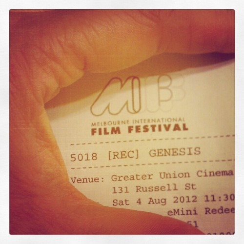 "Melbourne International Film Festival (MIFF) Day 1: [REC]³ Génesis. Spanish film with English subtitles. Screens with the impressive, low-budget short Australian zombie flick Perished. Like most adoring fans of the [REC] franchise, I came to this film brimming with excitement. REC³ Genesis (the third REC film) is the first of 15 films I'm watching at the MIFF. Unfortunately, this third instalment is disappointing - primarily because of it does not live up to the [REC] legacy. Taught and inventive, the first [REC] film was released in 2007, delivering effective horror and using the shaky cam mockumentary style to full effect. Written and directed by Jaume Balagueró and Paco Plaza and their other writing collaborator, Luiso (Luis) Berdejo, [REC] introduced horror fans to a strong new female protagonist.  Ángela Vidal  (played by Manuela Velasco) is a reporter who accompanies a fireman crew to an apartment building, her every move chronicled by her faithful cameraman. The audience soon learns that the apartment complex is home to an ever-increasing number of tenants who are infected with a mysterious virus that turns them into quick-limbered zombies. Velasco delivers a great performance that compelled the audience to care for her character as she screamed, ran, fought and crawled through the chaos and in the darkness.  The second film, [REC²], opens immediately where the first film leaves off, with a SWAT Team storming the apartment building seeking to restore order and to figure out what transpired. We view the unfolding mayhem through the SWAT members' helmet cams. The team is accompanied by a gravely serious priest who is motivated to stay in the building even as the body count rises, intent on seeking out the source of the zombie infestation.  These two [REC] films invigorated the zombie genre by blending supernatural and religious themes with a brilliant and frightening twist. Having established a relatively complex mythology explaining the zombie plague, fans flock to the latest film with assurance that this legend will take more thrilling and unexpected turns. Instead, we get a comedic and notably pedestrian fare. I feel conflicted about REC Genesis. If you've not seen the other two films, nor the competent American remakes, Quarantine and Quarantine 2: Terminal (also penned and helmed by the original Spanish writer-directors), then REC Genesis stands as an above average and enjoyable zombie romp. For fans of the first two REC films, it seems inevitable that you will be left wanting. The two leads in REC Genesis make an amiable pair to watch. Clara (played by Leticia Dolera) and Koldo (Diego Martín) are newlyweds whose wedding reception becomes the scene of a massacre as one of the guests carries the zombie infection, having crossed paths with one of the unfortunate tenants from the first film. Apart from this tenuous connection, Genesis does little to extend the story that evolved over the other REC films. There is more religious injection into this plot, but it lacks the provocative and terrifying lick of the previous films. The audience will still barrack for the survival of the young lovers in REC Genesis. The bride is played with beguiling gusto by Dolera, proving once again that these Spanish film-makers cast strong female leads without overly sexualising them. Nevertheless, the bride in Genesis incredulously chainsaws only one side of her wedding dress so her garter shows while she continues to run in ridiculously high heels throughout the latter part of the film. Such an ill conceived heterosexual male fantasy that women would want to, or be able to maintain, such ridiculous fashion choices during the zombie apocalypse! (It's a real thing, jeepers!) REC Genesis provides genuine laughs at times, but it is unconcerned with scaring its committed audience. Comedic zombie films have an established history, with horror master George Romero re-styling his Night of the Living Dead series as a horror comedy in the 1980s. The excessive gore in REC Genesis is played as slapstick. The narrative ambles along in entertaining but predictable grooves. Overall, the tone of this film lacks the punch of the previous REC movies, which unfurled as a clever, elongated fear feast. On the one hand, it is commendable that the REC writing-directing-producing team of three set out to reinvent and push their original story further into new territory, rather than playing it safe and delivering derivative thrills. On the other hand, in this particular case, the comedic horror style was a miscalculation for their established audience. The first two REC films stand together as a blistering example of the majesty of the horror genre. When horror films are conceived with passion for intelligent audiences, they deliver solid characters and stories of morality and human endurance through unexpected frights that delight. REC Genesis does not meet this promise, nor does it stand up to the calibre of its predecessors. Neither thrilling nor inventive, it doesn't move its audience's imagination nor does it inspire us to ponder and debate the macabre. Rating: Credit - 6.5 out of 10 Zombie Bites. A cut above the other zombie flicks plaguing our screens, but mediocre when held up to the first two trailblazing RECs. It screens at the MIFF again this Friday, should you bother going along? ""Short answer, 'Yes' with an 'If,' long answer: 'No' with a 'But'."" If you haven't seen the other RECs and you feel like a laugh, by all means go forth and zombie. Otherwise, I recommend you go instead to V/H/S (which I'll be reviewing next) or any of the other horror films screening at the MIFF, such as the Australian film 100 Bloody Acres, which looks ace. Can't wait to see it in general release."