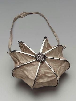 This is something that I want for this weekend!Heptagonal bag. French, about 1800 It's from the MFA (43.1609) and is described as an: Old rose moiré silk panels on steel cockade frame. Cut steel rosettes at rivets. Steel turn-key closure. White ribbon on steel rings. White silk lining. I feel bad that I posted sneak peeks of my ball gown on my facbook group and not here so I promise that will be up shortly.