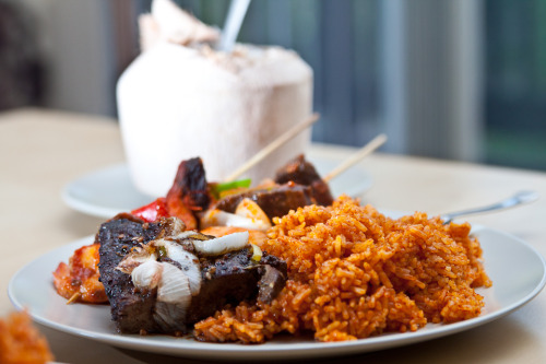 Jollof rice, Beef Liver, Shrimp and Beef Kebabs and Coconut