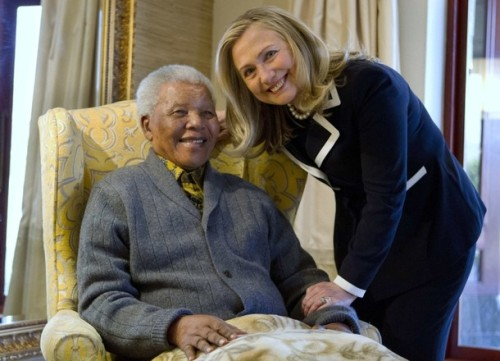 Hillary Clinton visits with Nelson Mandela, former President of South Africa during a recent visit to his home.