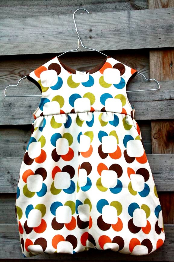 We happened upon this ultra cute toddler bubble dress made using our Retro Petals fabric from my very first fabric collection. Such a pleasant surprise! I absolutely love seeing what our customers are making with Lana Kole fabric. This made my morning even brighter :) Happy Tuesday! Lana