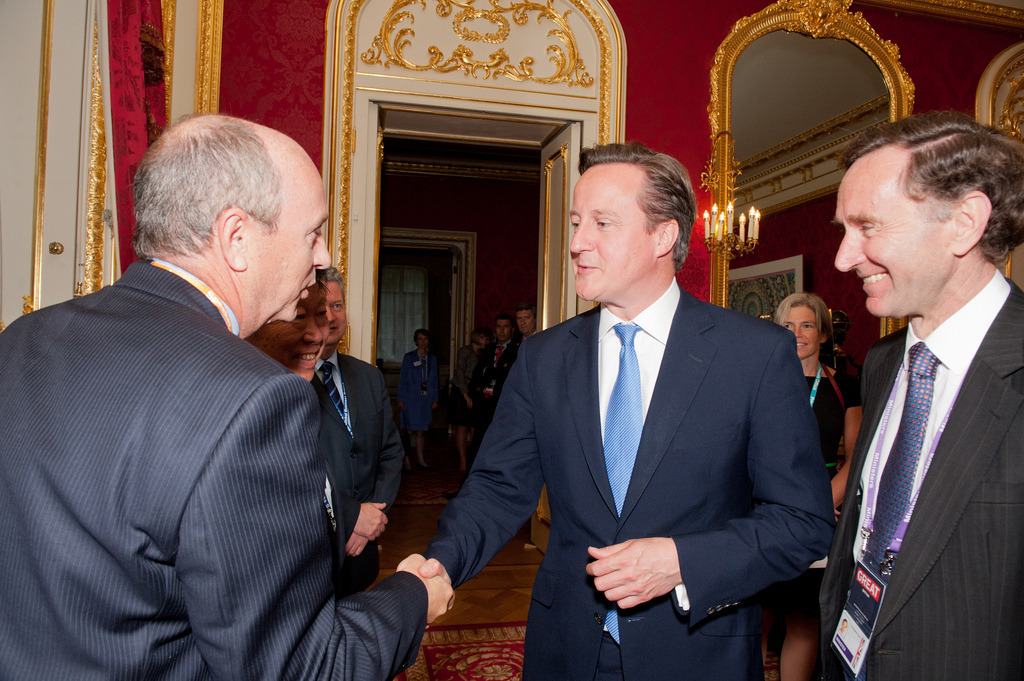 Prime Minister accompanied by Lord Green meets delegates at the Energy Day reception at Lancaster House, London on 6 August 2012. The reception was arranged as part of the British Business Summits.