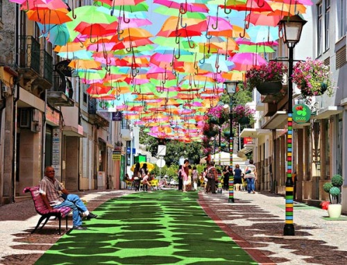 weandthecolor:  Umbrellas Installation A complete street in Agueda, Portugal decorated with colorful umbrellas floating in the air. Photography by Patricia Almeida. source: fubiz.net via: WE AND THE COLORFacebook // Twitter // Google+ // Pinterest